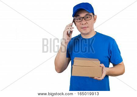 Asian Chinese Delivery Guy In Uniform Talking Over Mobile Phone
