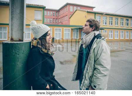 Portrait of young angry couple in disagreement after a quarrel outdoors. Bad relationships and couple problems concept.