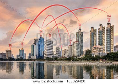 Concept of 5G network connection illustrated by smart city and buildings.