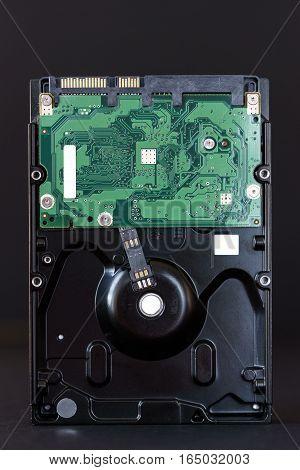 sata hdd hard disc drive on black background closeup.