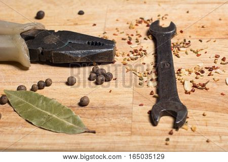 Spices On A Cutting Board And Man's Tools