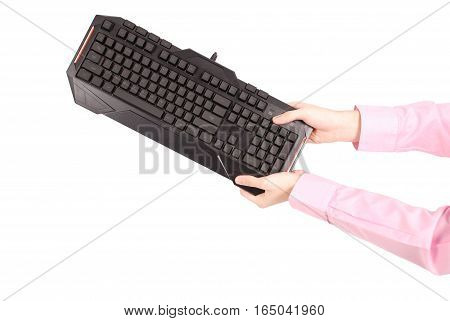 Teenage boy with computer keyboard isolated on white background
