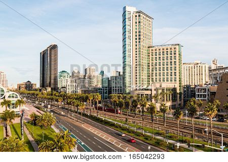 SAN DIEGO, CALIFORNIA - JANUARY 8, 2017:  The San Diego trolley travels on Harbor Drive, passing the San Diego Convention Center, hotels and Petco Park baseball stadium.