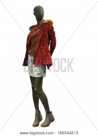 Full-length female mannequin dressed in red warm jacket. Isolated on white background. No brand names or copyright objects.
