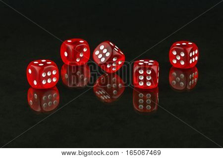 On the glass surface are recognized red dice