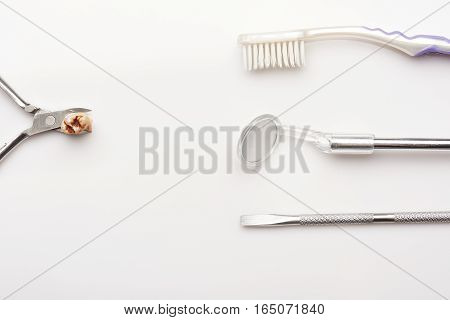 Cavity on extracted teeth brush,tools isolated on white background
