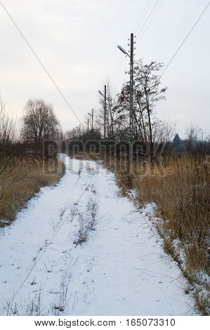 snow covered country road at the cold winter morning