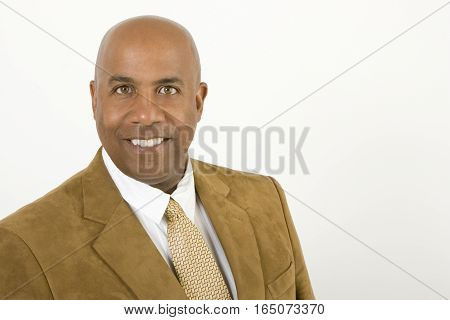Portrait of an African American businessman isolated on white.