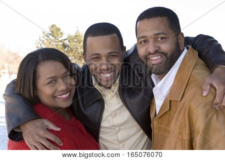 Portrait of an African American family smiling.