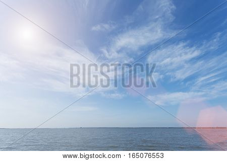 Soft Focus Of Blue Sky And Cloud With Flare. Vintage Filtered Nature Background.