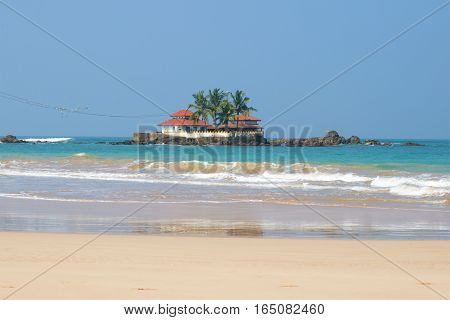 View of the Buddhist temple of Seenigama Muhudu Viharaya in the Indian Ocean. Neighborhood of the city of Hikkaduva, Sri Lanka