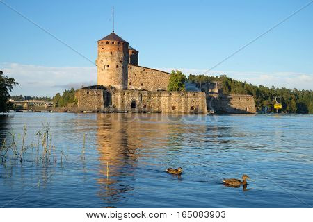 Olavinlinn's fortress on the Saimaa lake in the August evening. Savonlinna, Finland