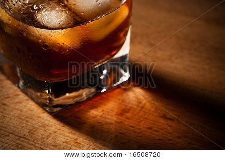 glasses from whiskey on a wooden table