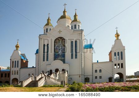 Christian orthodox white church with gold domes and crosses