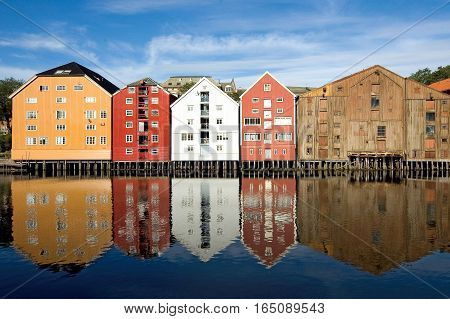 Trondheim, Nidaros historical name - the third most populous city in Norway, is situated at the mouth of the river Nidelva Trondheim fjord, colorful wooden houses along the banks of the fjord.