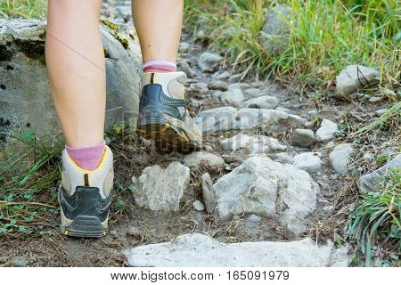 Close-up of the hiker's feet in the footpath