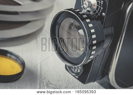 Old movie camera with film reels and color filter