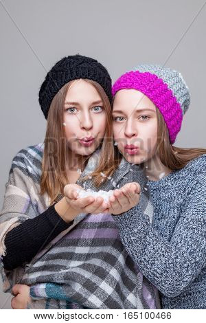 Twin Sisters Dressed In Warm Winter Clothes