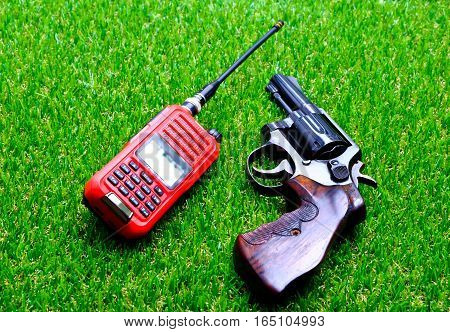 Revolver with a short-wave radio on the grass