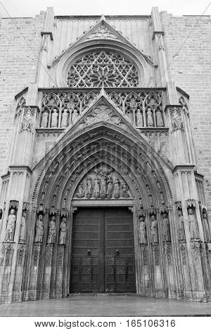 Valencia (Spain) exterior of the medieval cathedral in gothic style: facade. Black and white