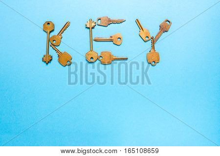 Key word is written inlaid keys on a blue background