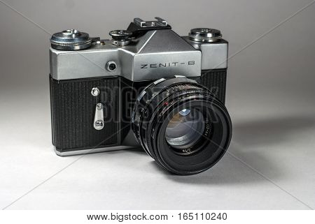 Gatchina, Russia - January 14, 2017: The old Soviet film camera Zenit. Photographed on a bright background. Perspective view 1.