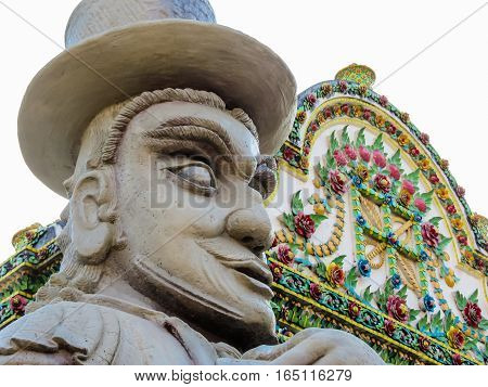 Stone statues in the ancient Wat Arun Temple or The Temple of Dawn. Bangkok, Thailand