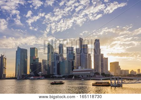 Singapore - January 07 2017: Singapore Cityscape Financial building with Dramatic Cloud in Marina Bay area SingaporeBoat Quay Golden Hour Urban Dusk