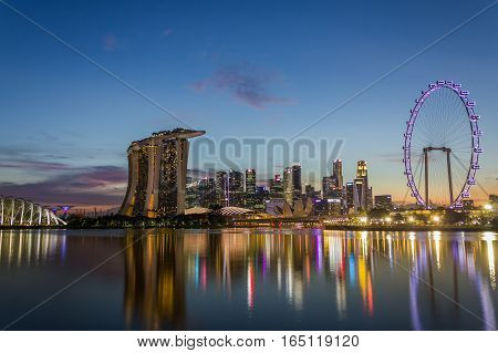 Singapore - January 7 2017: Urban Skyline and View of Skyscrapers at Sunset time in Singapore Dusk Landscape Waterfront