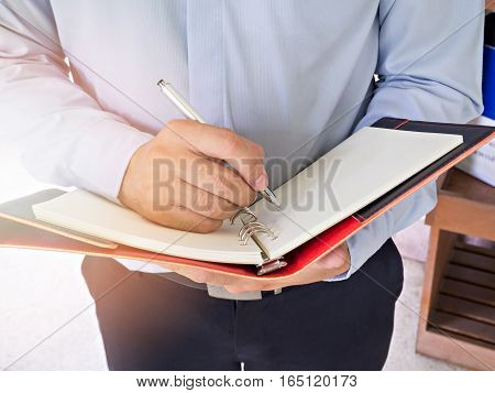 Close Up Shot Businessman Writing Notes In Notebook