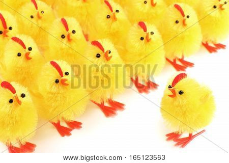 Easter, artificial chicks on a white background
