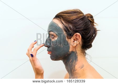 Mask Of Clay On The Girl's Face