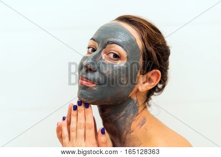 Mask Of Blue Clay On The Girl's Face