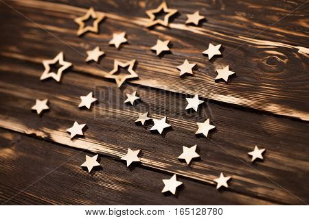 Wooden background with christmas wooden stars in the corner. Place for text