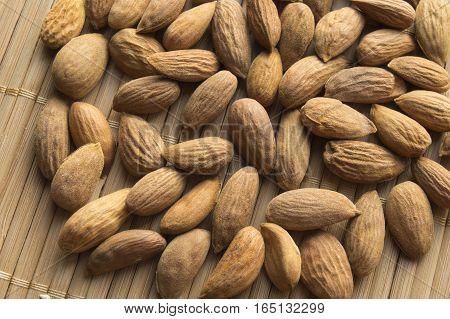 Almonds close up on a bamboo napkin. VEGA food, top view.
