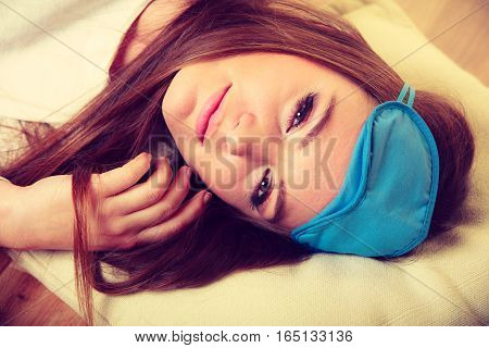 Brunette Woman Sleeping In Blue Eye Sleep Mask