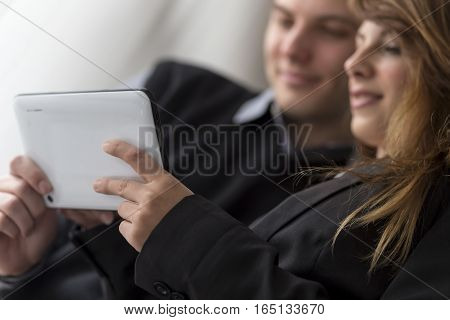 Business colleagues analyzing data on a tablet computer in an office