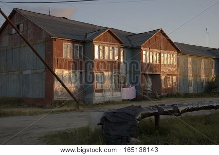 Misery and poor two-storeyed building in the evenong light
