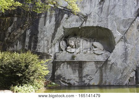 LUCERNE SWITZERLAND - MAY 04 2016: The monument of Dying Lion it is a World famous tourist attractions. Danish artist Thorwaldsen has carved lion in the rocky wall.
