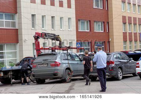 Nizhny Novgorod, Russia. - July 14.2016. The municipal tow truck evacuates wrong parked car in the Maxim Gorky street 117.