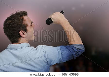 Handsome man singer performing at a concert