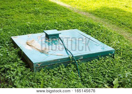 Green Cap Of Autonomous Sewage In Grass