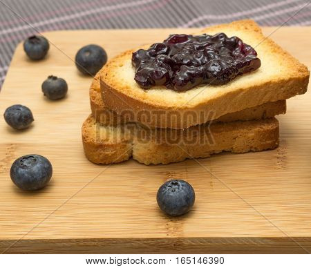Group of rusks and berries on white background