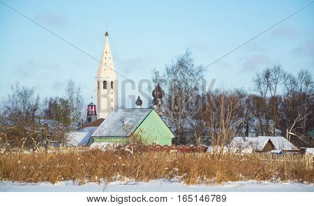 Winter rural landscape with a bell tower