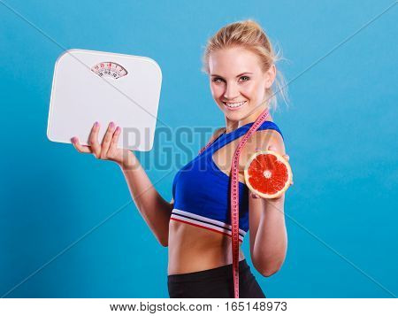 Fit Woman Holds Weight Scale Grapefruit