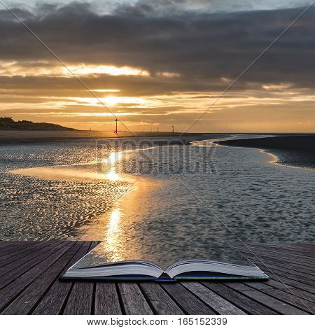 Beautiful Beach Coastal Low Tide Landscape Image At Sunrise With Colorful Vibrant Sky Coming Out Of