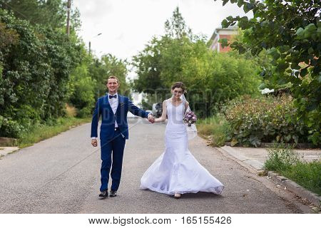 Happy bride and groom celebrating wedding day. Long family life concept
