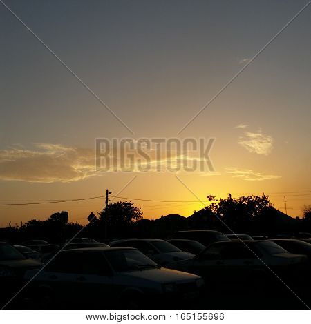 slowly floating clouds, beautiful sunset and machinery