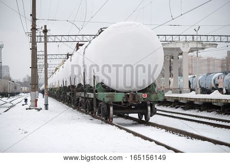 Railroad Cars Of White Color Stand At The Station