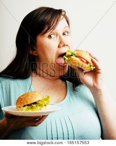 fat white woman having choice between hamburger and salad on white